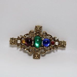 Vintage gold tone glass stone brooch